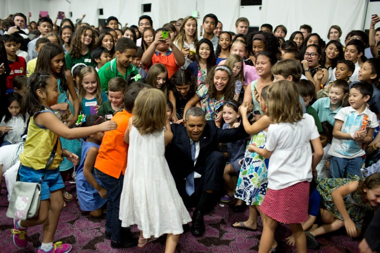 """April 28, 2014 """"'Help me up!', the President beckoned after posing for a photograph with children at the U.S. Embassy in Manila, the Philippines."""" (Official White House Photo by Pete Souza)"""
