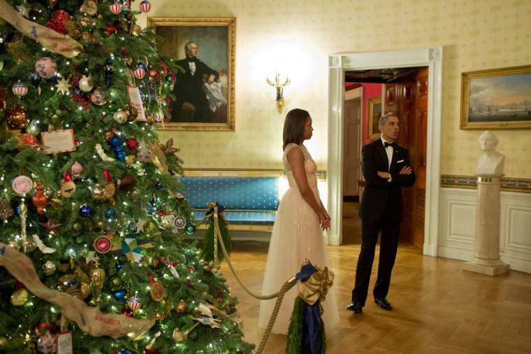 """Dec. 7, 2014 """"While waiting to be introduced before the Kennedy Center Honors reception at the White House, the President began whistling a Christmas song in the Blue Room."""" (Official White House Photo by Pete Souza)"""
