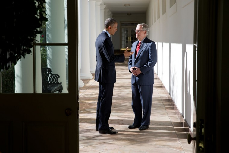 """Nov. 7, 2014 """"While walking with incoming Senate Majority Leader Mitch McConnell from the Oval Office to a lunch with other Congressional leaders, the President stopped on the White House colonnade to discuss the upcoming Congressional session."""" (Official White House Photo by Pete Souza)"""