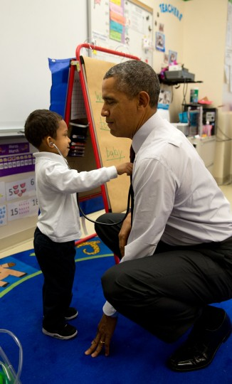 """March 4, 2014 """"The President was visiting a classroom at Powell Elementary School in Washington, D.C. A young boy was using a stethoscope during the class, and as the President was about to leave the room, the President asked him to check his heartbeat."""" (Official White House Photo by Pete Souza)"""