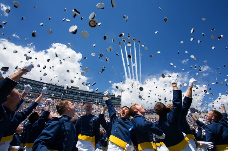 """May 28, 2014 """"Cadets toss their hats in the air as the Thunderbirds fly over Falcon Stadium at the United States Air Force Academy Commencement ceremony, in Colorado Springs, Colorado."""" (Official White House Photo by David Lienemann)"""