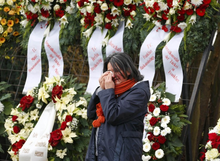 A mourner cries at the cemetry before the burial of late student Tugce Albayrak in Bad Soden-Salmuenster, December 3, 2014. Tugce Albayrak, 23, was beaten up in mid-November in front of a fast food in Offenbach near Frankfurt, as she tried to defend two girls. She was in coma since then and died on November 28 when her family allowed doctors to switch off her life support, on the day of her birthday. (Ralph Orlowski/Reuters photo)