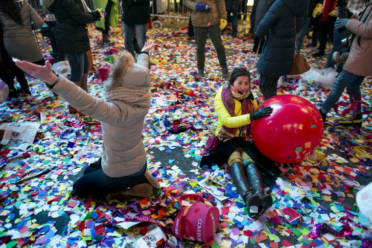 Revelers enjoy confetti in Times Square after midnight during New Year's Eve festivities in New York. (Craig Ruttle/AP photo)