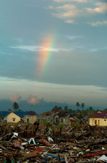 A partial rainbow flares above the rubble at sunset Tuesday, Jan. 18, 2005 following a tsunami that ripped through the Aceh province December 26th. (Karl Merton Ferron, Baltimore Sun)