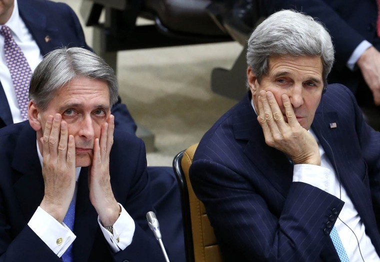 British Foreign Secretary Philip Hammond, left, and U.S. Secretary of State John Kerry, right, attend a NATO foreign ministers meeting at the Alliance's headquarters in Brussels December 2, 2014. (Yves Herman/Reuters photo)