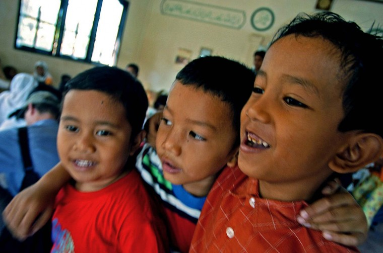 From left, Sultan, 4, Ikram, 6, and Kiki, 7 walk arm in arm at Camp MNS Desa Lamgugop Monday, Jan. 17 2005. Save The Children has begun sponsoring safe spaces for the children, who have been victimized by a tsunami that swept through the town in December. (Karl Merton Ferron, Baltimore Sun)