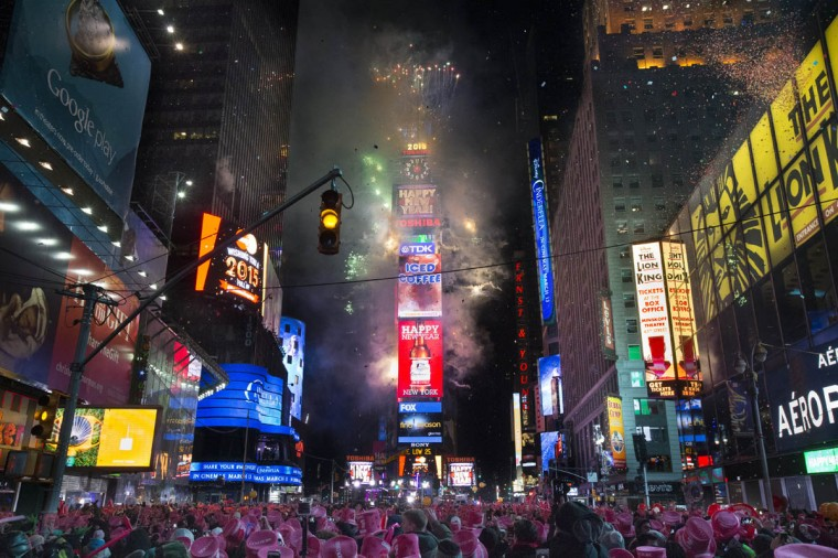 Fireworks erupt after midnight in Times Square during the New Year's Eve celebration, Thursday, Jan. 1, 2015, in New York. Thousands braved the cold to watch the annual ball drop and ring in the new year. (John Minchillo/AP photo)