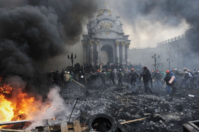 Protesters advance towards new positions in Kiev on February 20, 2014. Armed protesters stormed police barricades in Kiev on Thursday in renewed violence that killed at least 26 people and shattered an hours-old truce as EU envoys held crisis talks with Ukraine's embattled president. Bodies of anti-government demonstrators lay amid smouldering debris after masked protesters hurling Molotov cocktails and stones forced police from Kiev's iconic Independence Square -- the epicentre of the ex-Soviet country's three-month-old crisis. Louisa Gouliamaki/AFP/Getty Images