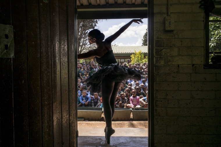 Senior soloist of the Joburg Ballet Kitty Phetla performs in a classroom at the Nka-Thuto Primary School in Soweto on October 16, 2014. Using ballet and dance to promote healthy and positive choices, Joburg Ballet will provide lecture demonstrations to twenty schools in Soweto, raising awareness and informing students of the available free classes they provide together with the provincial department of education. MARCO LONGARI/AFP/Getty Images