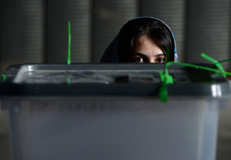 An Afghan election commission worker waits prior to the opening of the seals to a box containing ballot papers for an audit of the presidential run-off votes at a counting centre in Kabul on July 17, 2014. Afghanistan on July 17 began a massive audit of 8.1 million ballots cast in the run-off round of its controversial presidential vote, hours after a brazen Taliban raid on Kabul's airport. The audit is aimed at reversing a destabilising political crisis that has threatened to widen the country's ethnic fissures as NATO winds down its deployment after more than a decade of war. WAKIL KOHSAR/AFP/Getty Images