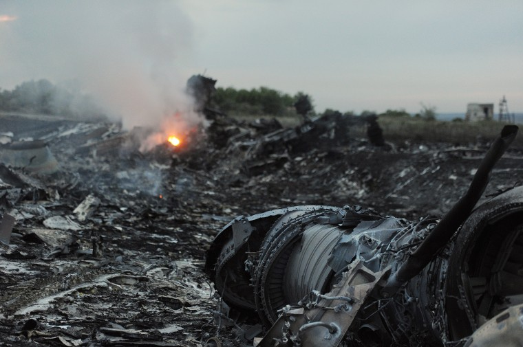 A picture taken on July 17, 2014 shows wreckages of the malaysian airliner carrying 295 people from Amsterdam to Kuala Lumpur after it crashed, near the town of Shaktarsk, in rebel-held east Ukraine. Pro-Russian rebels fighting central Kiev authorities claimed on Thursday that the Malaysian airline that crashed in Ukraine had been shot down by a Ukrainian jet. DOMINIQUE FAGET/AFP/Getty Images