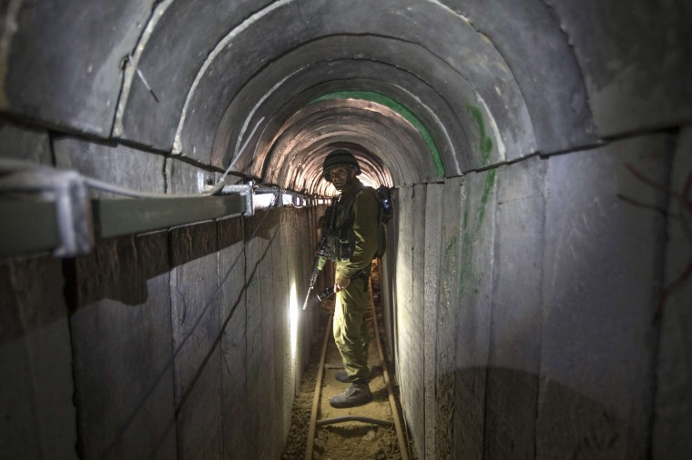 An Israeli army officer walks on July 25, 2014 during an army-organised tour in a tunnel said to be used by Palestinian militants from the Gaza Strip for cross-border attacks. Israel launched its military offensive aiming at destroying tunnels used by Gaza militants. JACK GUEZ/AFP/Getty Images