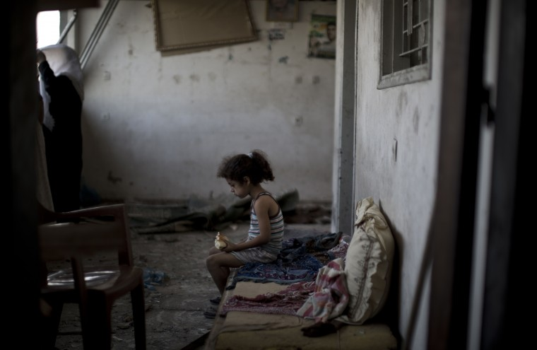 A Palestinian girl sits and eats in the rubble of her destroyed home, on August 2, 2014 following an overnight Israeli strike on Gaza City. A fresh wave of violence killed dozens in Gaza after the collapse of a UN and US backed ceasefire, officials said, as Hamas denied it kidnapped an Israeli soldier. MAHMUD HAMS/AFP/Getty Images