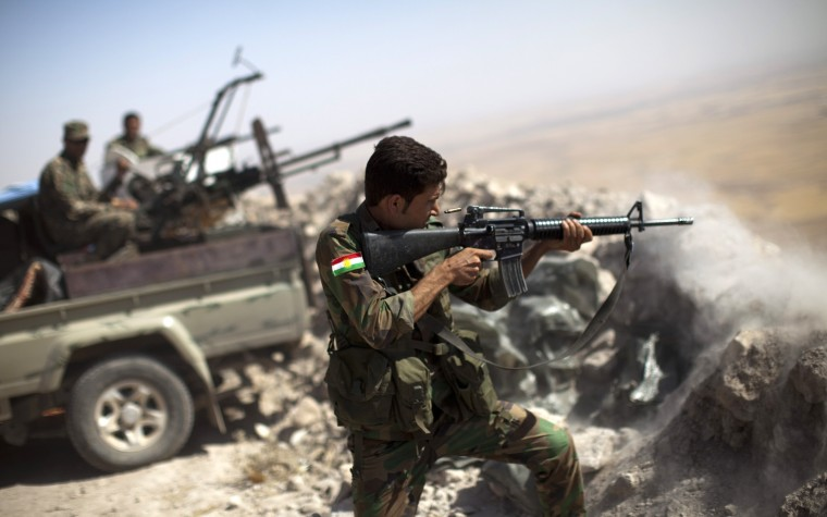 An Iraqi Kurdish Peshmerga fighter fires at Islamic-State (IS) militant positions, from his position on the top of Mount Zardak, a strategic point taken 3 days ago, about 25 kilometres east of Mosul on September 9,2014. Kurdish forces in the north have been bolstered by US strikes and took control of Mount Zardak, a strategic site that provides a commanding view of the surrounding area, a senior US officer said. JM LOPEZ/AFP/Getty Images