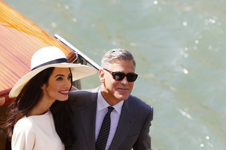US actor George Clooney and British lawyer Amal Alamuddin leave the palazzo Ca Farsetti on a taxi boat on September 29, 2014 in Venice, after a civil ceremony to officialise their wedding. PIERRE TEYSSOT/AFP/Getty Images