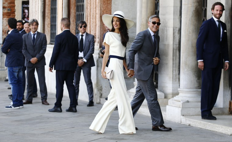 US actor George Clooney and British lawyer Amal Alamuddin arrive on September 29, 2014 at the palazzo Ca Farsetti in Venice, for a civil ceremony to officialise their wedding. PIERRE TEYSSOT/AFP/Getty Images