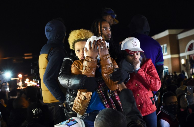 Michael Brown's mother Leslie McSpadden (C) and other protesters react after hearing the grand jury decision in the fatal shooting of her son in Ferguson, Missouri, on November 24, 2014. Violent protests and looting erupted in the US town of Ferguson after a grand jury chose not to press charges against a white officer who shot dead the black teen. US President Barack Obama and the family of late 18-year-old Michael Brown separately appealed for calm after a prosecutor said a grand jury had found the policeman acted in self-defense. JEWEL SAMAD/AFP/Getty Images