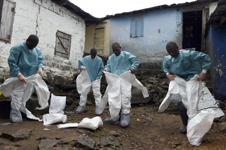 Medical staff members of the Croix Rouge NGO put on protective suits before collecting the corpse of a victim of Ebola, in Monrovia, on September 29, 2014. Of the four west African nations affected by the Ebola outbreak, Liberia has been hit the hardest, with 3,458 people infected -- more than half of the total number of cases. Of those, 1,830 have died, according to a WHO count released on September 27. PASCAL GUYOT/AFP/Getty Images