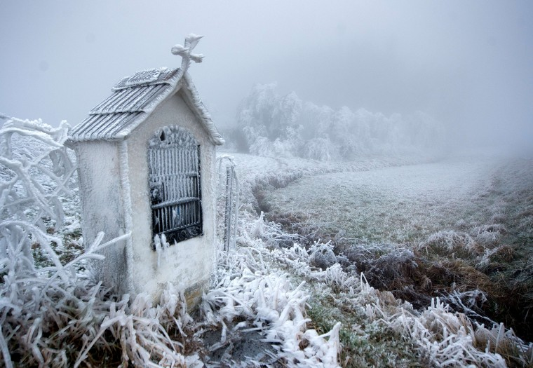 A road shrine is covered with frost near Kottes in Lower Austria, on December 3, 2014. (Christian Bruna/AFP/Getty Images)