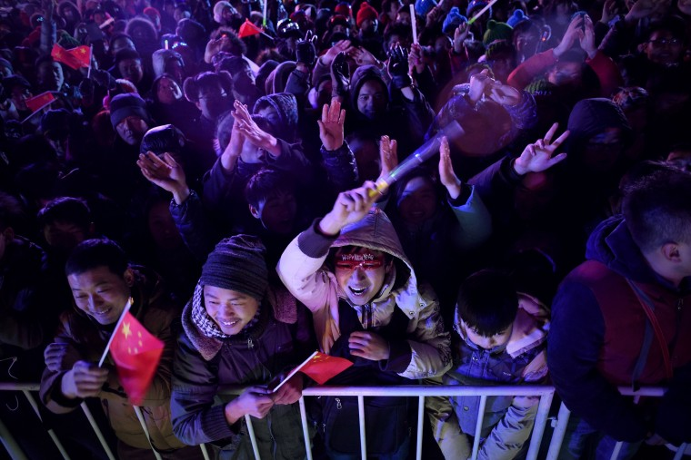 People cheer to wish in the new year during a New Year's Eve countdown event in front of Beijing's National Stadium, Known as the Bird's Nest in Beijing, on December 31,2014. Beijing is bidding to host the 2022 Winter Olympic Games, with a decision on the winning city to be made in July 2015. (Wang Zhao/AFP/Getty Images)
