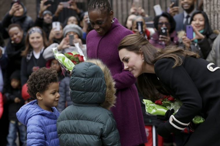Catherine, Duchess of Cambridge right, and Chirlane McCray, the wife of the mayor of New York City, center, receive flowers from Andrew, 5, left, and Mila, 6, before leaving Northside Center for Child Development during her official two-day visit to the United States on December 8, 2014 in New York City. (Seth Wenig-Pool/Getty Images)
