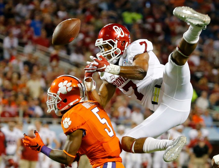 Germone Hopper #5 of the Clemson Tigers attempts a reception against Jordan Thomas #7 of the Oklahoma Sooners during the Russell Athletic Bowl at Florida Citrus Bowl in Orlando, Florida. (Sam Greenwood/Getty Images)