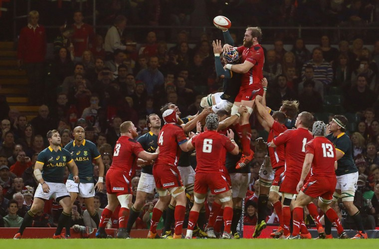 South Africa's Victor Matfield (up left) and Wales' Alun Wyn Jones jump for the ball in the line out during the Autumn International rugby union Test match at the Millennium Stadium in Cardiff, south Wales, on November 29, 2014. (GEOFF CADDICK/AFP/Getty Images)