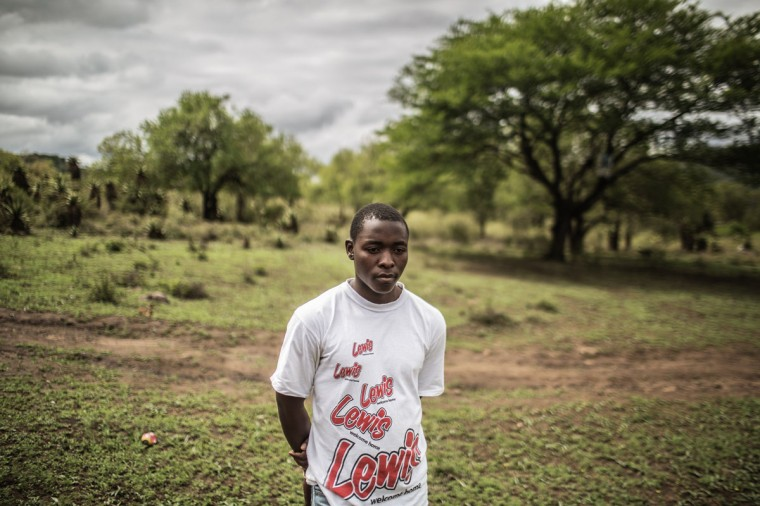 A South African boy from a rural area in the KwaZulu Natal province waits on the road to be picked up by health workers working with Doctors Without Borders (MSF) to undergo medical circumcision as a form of HIV prevention in the Mbongolwane district. (GIANLUIGI GUERCIA/AFP/Getty Images)