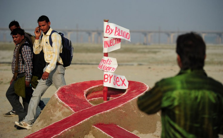 Indian residents walk past a sand sculpture made by fine-art students from Allahabad University to highlight AIDS awareness on the eve of 'World AIDS Day' at Sangam in Allahabad on November 30, 2014. World AIDS Day is marked annually on December 1. (Sanjay Kanojia/AFP/Getty Images)