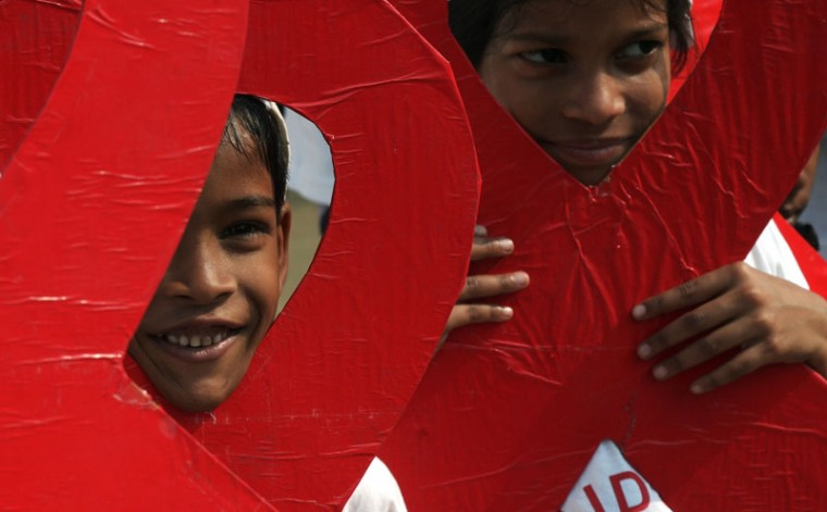 Indian children and social activists take part in an event to create awareness about AIDS on the eve of world AIDS day in Kolkata on November 30, 2014. World AIDS Day is marked annually on December 1. (Dibyangshu Sakar/AFP/Getty Images)