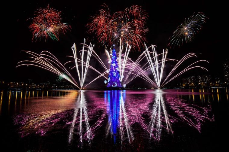 View of fireworks during the inauguration of an 85-meter-high floating Christmas tree at Rodrigo de Freitas lagoon in Rio de Janeiro, Brazil, on November 29, 2014. (YASUYOSHI CHIBA/AFP/Getty Images)