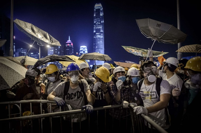 Pro-democracy protesters face police forces during clashes at a pro-democracy rally in the Admiralty district of Hong Kong on November 30, 2014. (PHILIPPE LOPEZ/AFP/Getty Images)