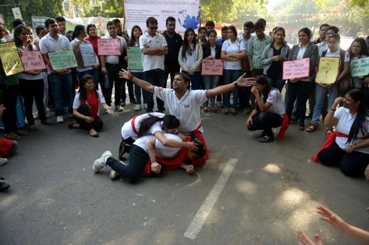 Indian students perform a street play to create awareness of HIV infection and prevention methods to commemorate World AIDS Day in New Delhi on December 1, 2014. According to the UN AIDS program,Indiahad the third-largest number of people living with HIV in the world at the end of 2013 and it accounts for more than half of all AIDS-related deaths in the Asia-Pacific region. In 2012, 140,000 people died inIndiabecause of AIDS. TheIndian government has been providing free antiretroviral drugs for HIV treatment since 2004, but only 50 percent of those eligible for the treatment were getting it in 2012, according to a report by the World Health Organization. (Sajiad Hussain/AFP/Getty Images)