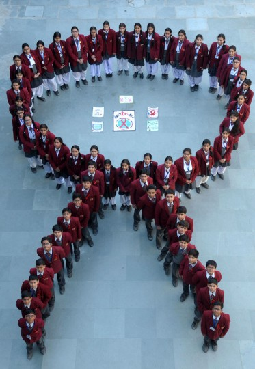 Indian school students pose for a photograph in the shape of a ribbon during an awareness campaign to mark World AIDS Day at a school in Amritsar on December 1, 2014. The UNAIDS agency says some 2.5 million Indians are living with HIV, many of them ostracized by their communities. (Narinder Nanu/AFP/Getty Images)