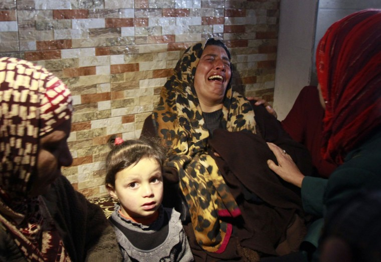 The mother of Amal Jihad Taqatqa, a Palestinian woman from Beit Fajjar near the West Bank city of Bethlehem, cries in her home on December 1, 2014, after her daughter attacked an Israeli civilian in the Gush Etzion settlement bloc, south of Bethlehem. The Israeli army shot and wounded Amal Jihad Taqatqa after she stabbed an Israeli civilian in the Jewish settlement bloc in the southern West Bank, the military said. The attack was the first by a Palestinian woman in a wave of unrest in Israel and the occupied territories, and comes as tensions run high particularly in Jerusalem and nearby areas of the West Bank. (MUSA AL-SHAER/AFP/Getty Images)
