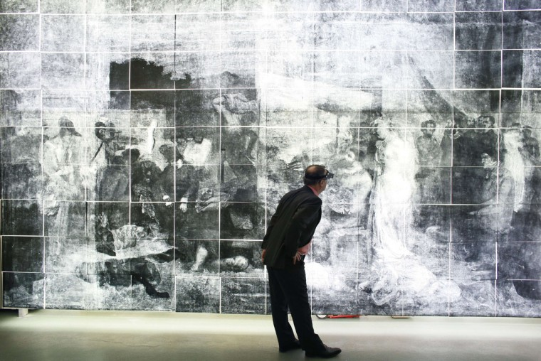 Head curator in charged of painting studies at the French Museums Research and Restoration centre (C2RMF) Bruno Mottin looks at a full-size X-ray of a painting 'L'Atelier du Peintre' ('The Artist's studio') by late French artist Gustave Courbet prior to restore it, on December 1, 2014 at the Louvre Museum in Paris. (PATRICK KOVARIK/AFP/Getty Images)