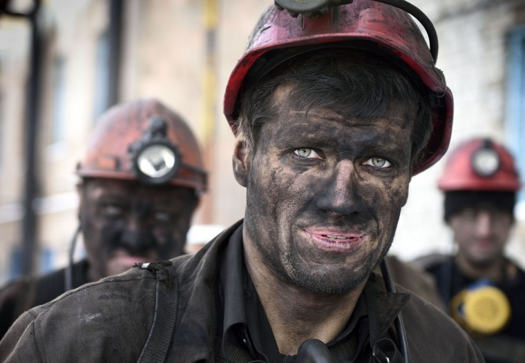 Miners return from their shift at the Kalinina coal mine in the eastern Ukrainian city of Donetsk, controlled by pro-Russian rebels on December 1, 2014. (ERIC FEFERBERG/AFP/Getty Images)