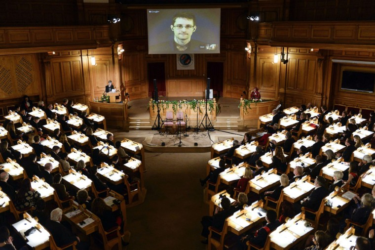 Fugitive US intelligence leaker Edward Snowden is shown on a livestream from Moscow during the Right Livelihood Award ceremony at the Swedish Parliament, in Stockholm, on December 1, 2014. Snowden was awarded the Right Livelihood Honorary Award 'for his courage and skill in revealing the unprecedented extent of state surveillance violating basic democratic processes and constitutional rights. The Right Livelihood Award was founded by journalist and professional philatelist Jakob von Uexkull in 1980. (PONTUS LUNDAHL/AFP/Getty Images)
