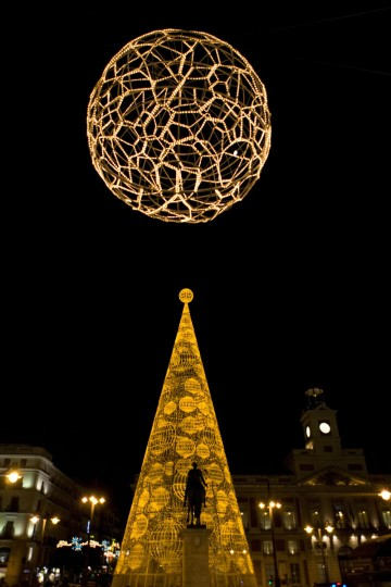 A Christmas tree illuminates Puerta del Sol in the centre of Madrid on December 1, 2014. (Sebastien Berda/AFP/Getty Images)