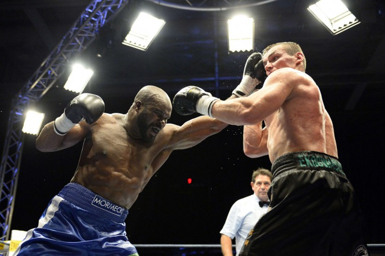 Two-time former WBC and WBA cruiserweight champion Jean-Marc Mormeck (left) of France fights former EBU cruiserweight champion Polish Mateusz Masternak on December 5, 2014 in the Paris suburb of Issy-les-Moulineaux. (BERTRAND GUAY/AFP/Getty Images)
