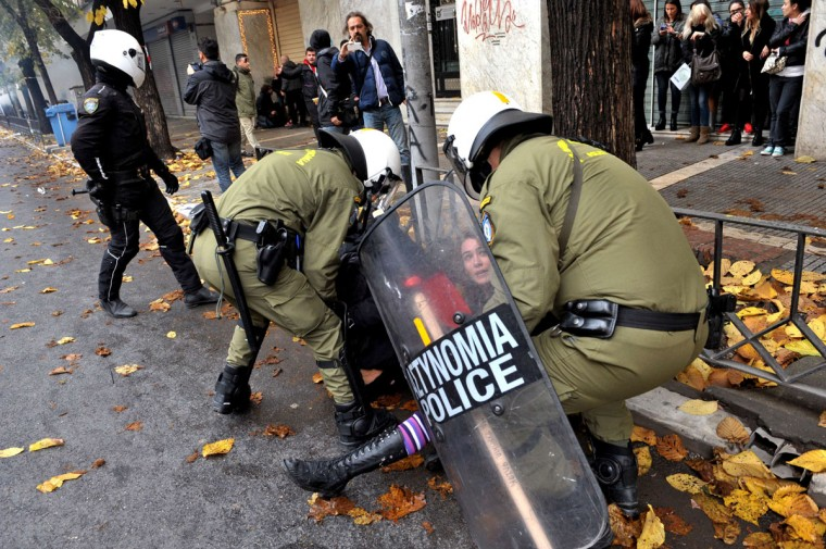 Riot police detain a demonstrator on December 6, 2014, during a protest to commemorate the six-year anniversary of the fatal shooting of teenager Alexis Grigoropoulos by a police officer, an event that plunged Greece into weeks of youth riots. The commemoration is held as a close friend of Grigoropoulos, 21-year-old anarchist Nikos Romanos, jailed for attempted bank robbery, is on the 26th day of a hunger strike. (SAKIS MITROLIDIS/AFP/Getty Images)