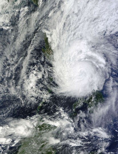 In this image obtained from NASA, Typhoon Hagupit hits the Philippines on December 7, 2014. Typhoon Hagupit tore apart homes and dumped fierce rains across the eastern Philippines on Sunday, killing at least two people while creating more misery for millions after a barrage of deadly disasters. The typhoon roared in from the Pacific Ocean and into remote fishing communities on Samar island on Saturday night with wind gusts of 210 kilometres (130 miles) an hour, local weather agency Pagasa said. The wind strength at landfall made Hagupit the most powerful storm to hit the Philippines this year, exceeding a typhoon in July that killed more than 100 people. (AFP Photo Handout- NASA)