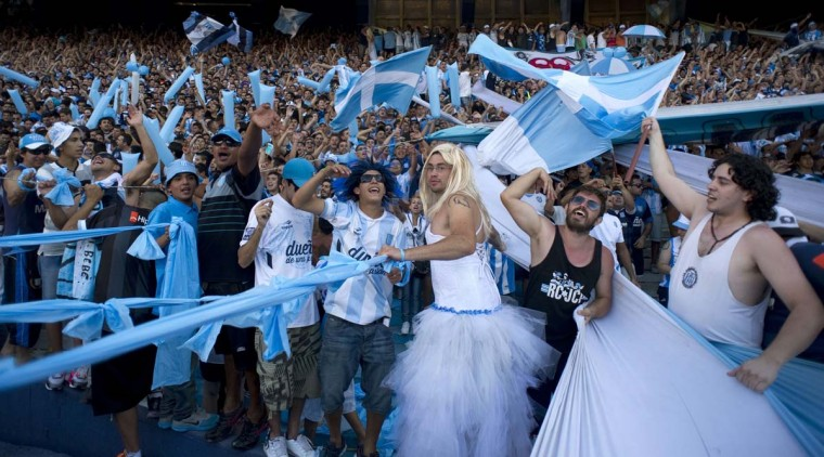 Supporters of Racing Club's cheer their team during their Argentine First Division football match against Godoy Cruz, at Presidente Juan Domingo Peron stadium in Buenos Aires, Argentina, on December 14, 2014. (Alejandro Pagni/AFP/Getty Images)