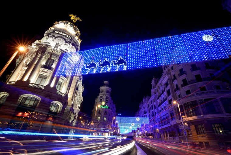 Cars pass under Christmas lights illuminating Gran Via in the centre of Madrid on December 16, 2014. (Dani Pozo/AFP/Getty Images)