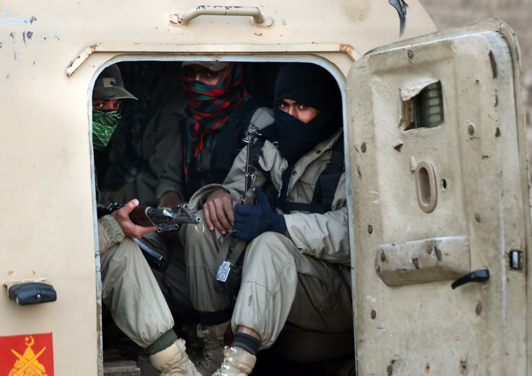 Pakistani army soldiers sit in an armoured vehicle as they patrol the perimiter of a school in Peshawar on December 17, 2014, the day after an attack on the army run establishment in the northern city. Pakistan has begun three days of mourning for the 132 schoolchildren and nine staff killed by the Taliban in the country's deadliest ever terror attack as the world united in a chorus of revulsion. The 141 people were killed when insurgents stormed an army-run school in the northwestern city of Peshawar on Tuesday and systematically went from room to room shooting children during an eight-hour killing spree. Farooq Naeem/AFP/Getty Images