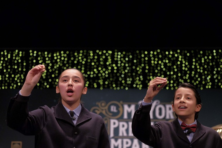 """Pupils from San Ildefonso school call out the winning number, 13437, during the draw of Spain's Christmas lottery named """"El Gordo"""" (Fat One) in Madrid, on December 22, 2014. (Pedro Armestre/AFP/Getty Images)"""