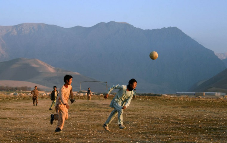 Afghan children play football in a field in a village on the outskirts of Mazar-i-Sharif. Football is a popular sport in the war-torn country, with the Afghan national football team winning last years South Asian Football Federation Cup. (Farshad Usyan/Getty Images)