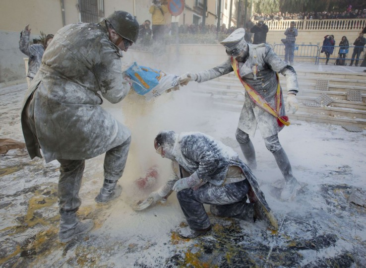 "Revelers, dressed in mock military uniforms, take part in the battle of ""Enfarinats"", a flour fight, in the town of Ibi, south-eastern Spain, on December 28, 2014. (JAIME REINA/AFP/Getty Images)"