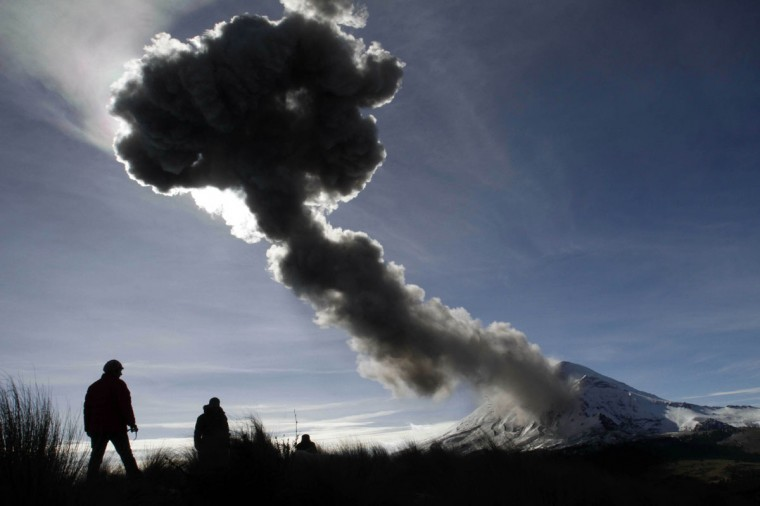 People look at the Popocatepetl volcano as it spews ash from the Paso de Cortes community, in Puebla State, Mexico. ( J Guadalupe Perez/AFP/Getty Images)