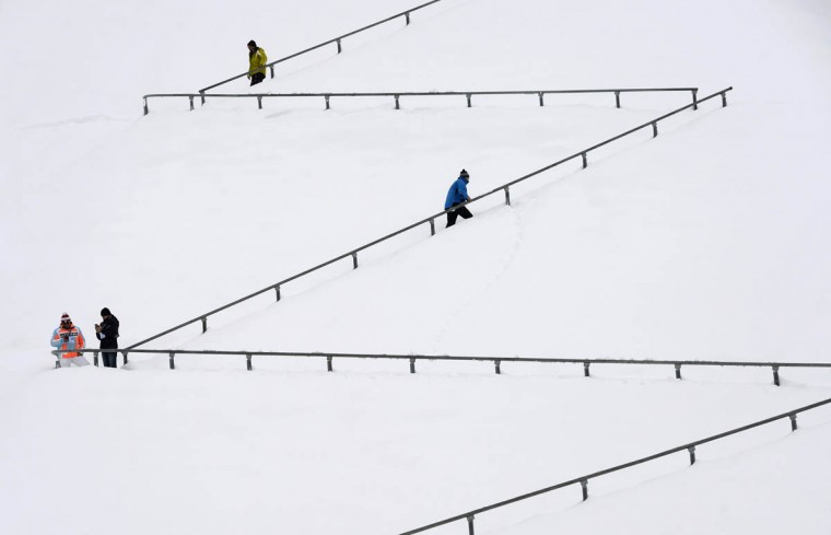 People walk at a snowy stairs of the Garmisch-Partenkirchen hill ahead the qualification jump of the second session of the Four-Hills Ski jumping tournament (Vierschanzentournee) in Garmisch-Partenkirchen, southern Germany on December 31, 2014. The second competition of the Four-Hills Ski jumping event takes place in Garmisch-Partenkirchen, before the tournament continues in Innsbruck (Austria) and in Bischofshofen (Austria). (Christof Stache/Getty Images)